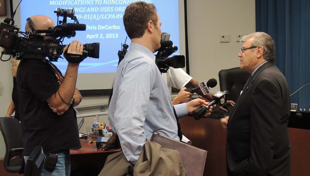 Mayor Matt Hall (right) answers questions from local television media after the City Council declared its approval of the Quarry Creek project with 656 homes at the April 2 meeting. Photo by Rachel Stine