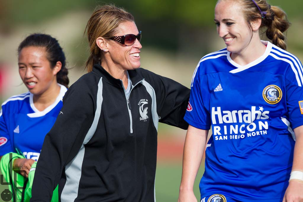San Diego SeaLions' head coach Jen Lalor-Nielsen (center) meets with players on the field last season. This year, Nielsen and general manager Amie Becker are setting new goals for the team. Photo by Aaron Jaffe