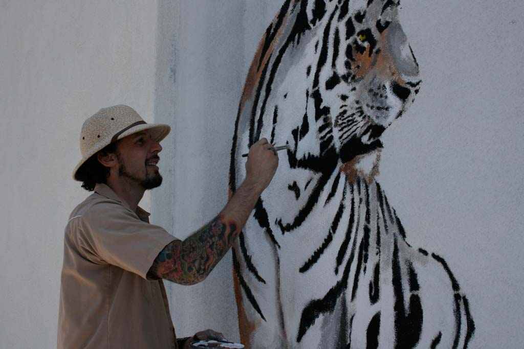 Michael Summers will be painting his mural at 2906 Carlsbad Blvd. through May 10. The Mural Project also includes murals by artists Jason Markow, Ron Juncal and Phyllis Swanson, and Lauren Lee. Photo by Promise Yee