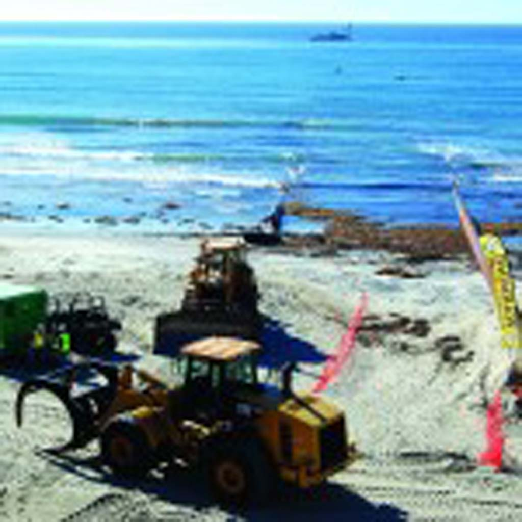 Sand is taken from offshore and dumped at Fletcher Cover in Solana Beach as part of a beach replenishment project this winter. Next Wednesday at 6 p.m., the Encinitas City Council will vote on a critical step of a joint sand replenishment project. Photo by Bianca Kaplanek