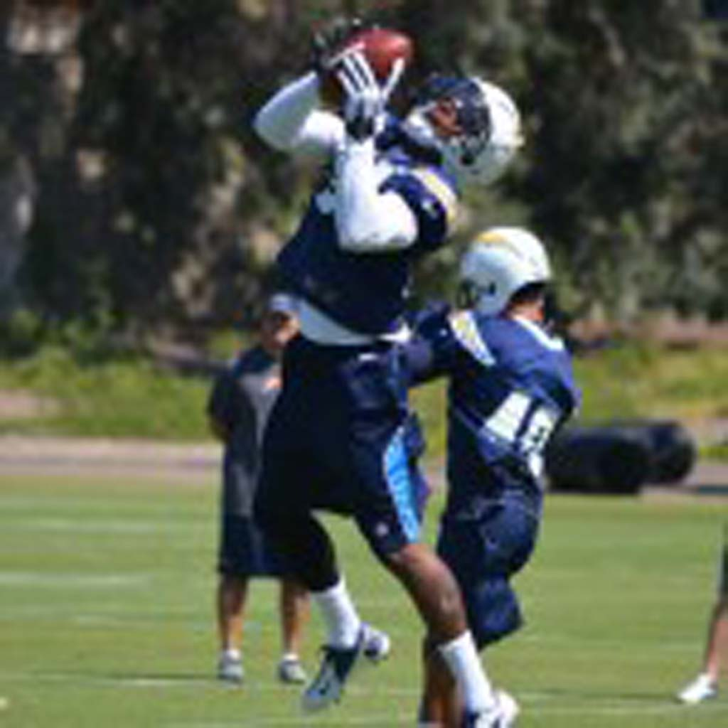 Cornerbacks Marcus Gilchrist, left, and Sean Cattouse take part in OTA drills Monday. Photo by Tony Cagala