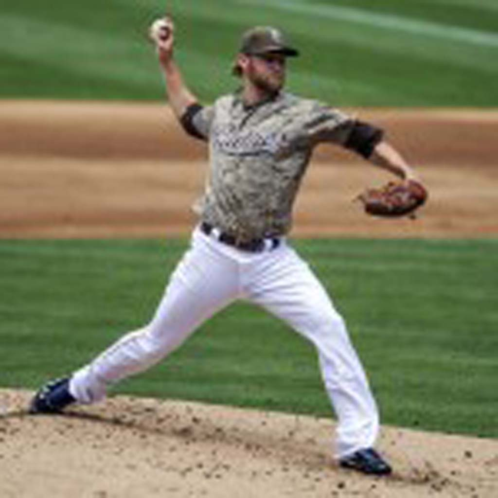 San Diego Padres pitcher Andrew Cashner throws eight strong innings, allowing only one earned run on Sunday against the Los Angeles Dodgers. The Dodgers would win the game 3-1 in the ninth on a two-run homerun by Adrian Gonzalez off of closer Huston Street. Photo by Bill Reilly
