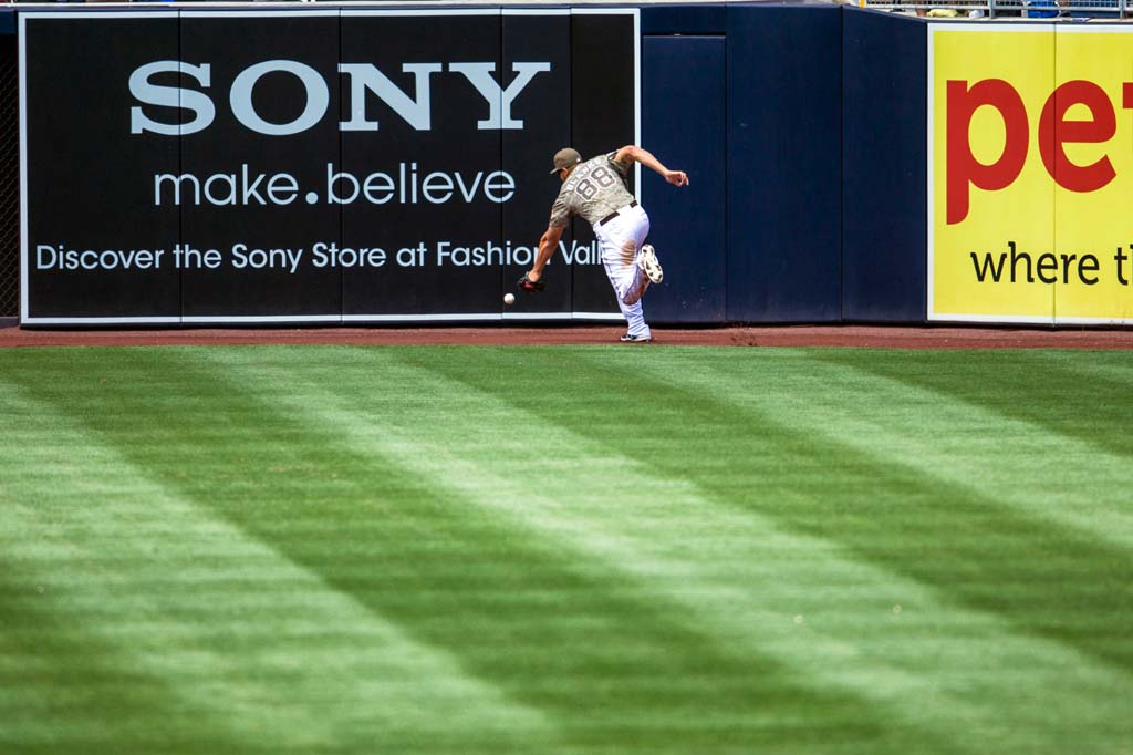 San Diego Padres outfielder Kyle Blanks plays a ball that took a bounce off the right field wall at Petco Park. Photo by Bill Reilly