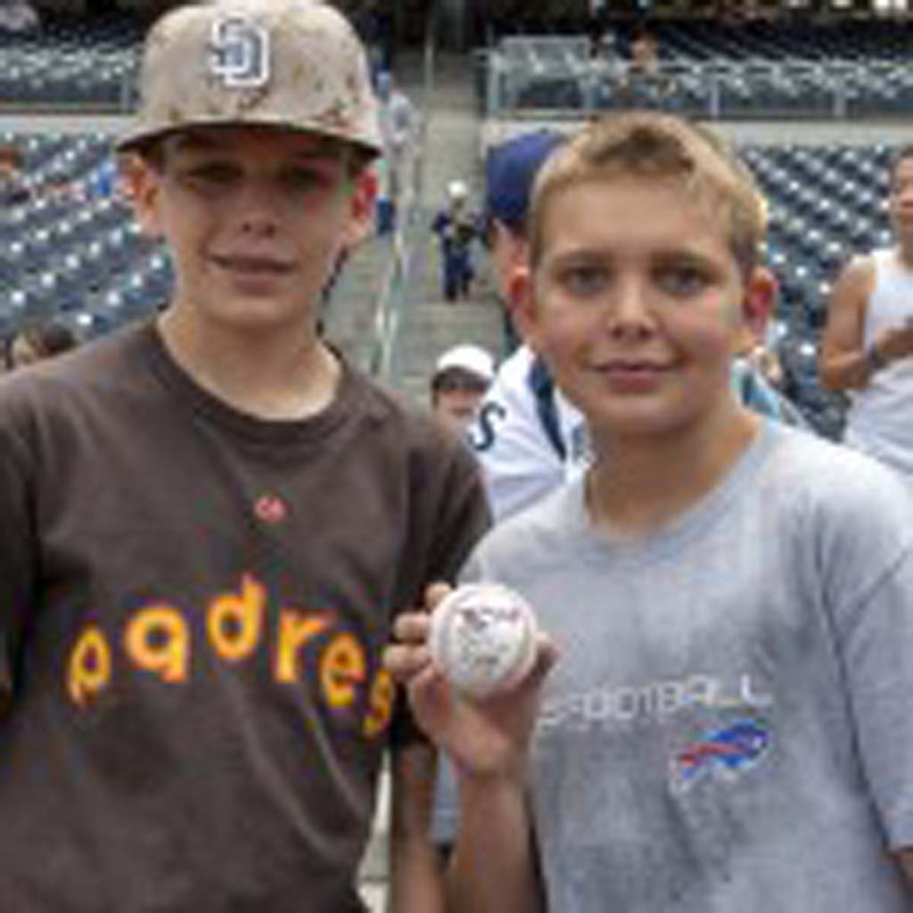 Austin Ray and his brother Spencer of Del Mar wait on the first baseline for San Diego Padres players' autographs. Photo by Bill Reilly