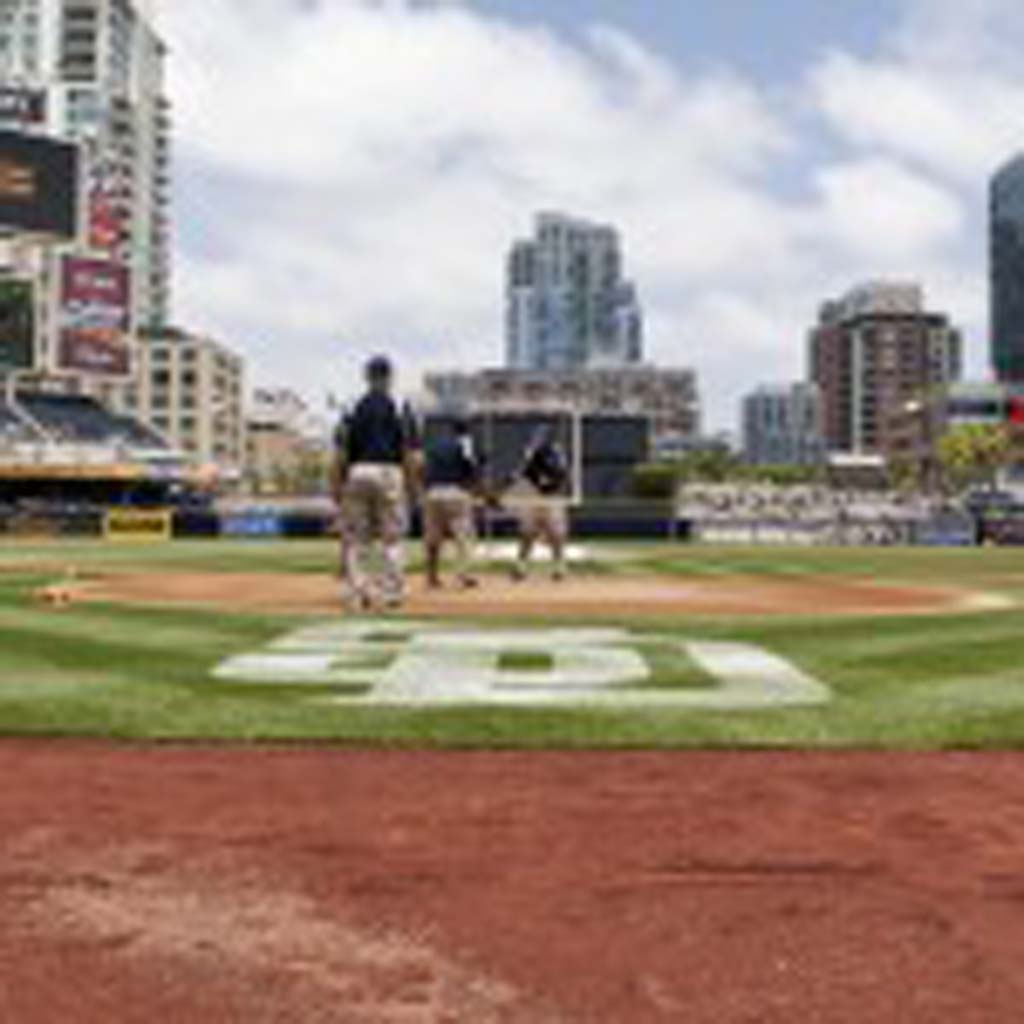 The San Diego Padres grounds crew prepares the infield before Sunday's game against the Dodgers. Photo by Bill Reilly