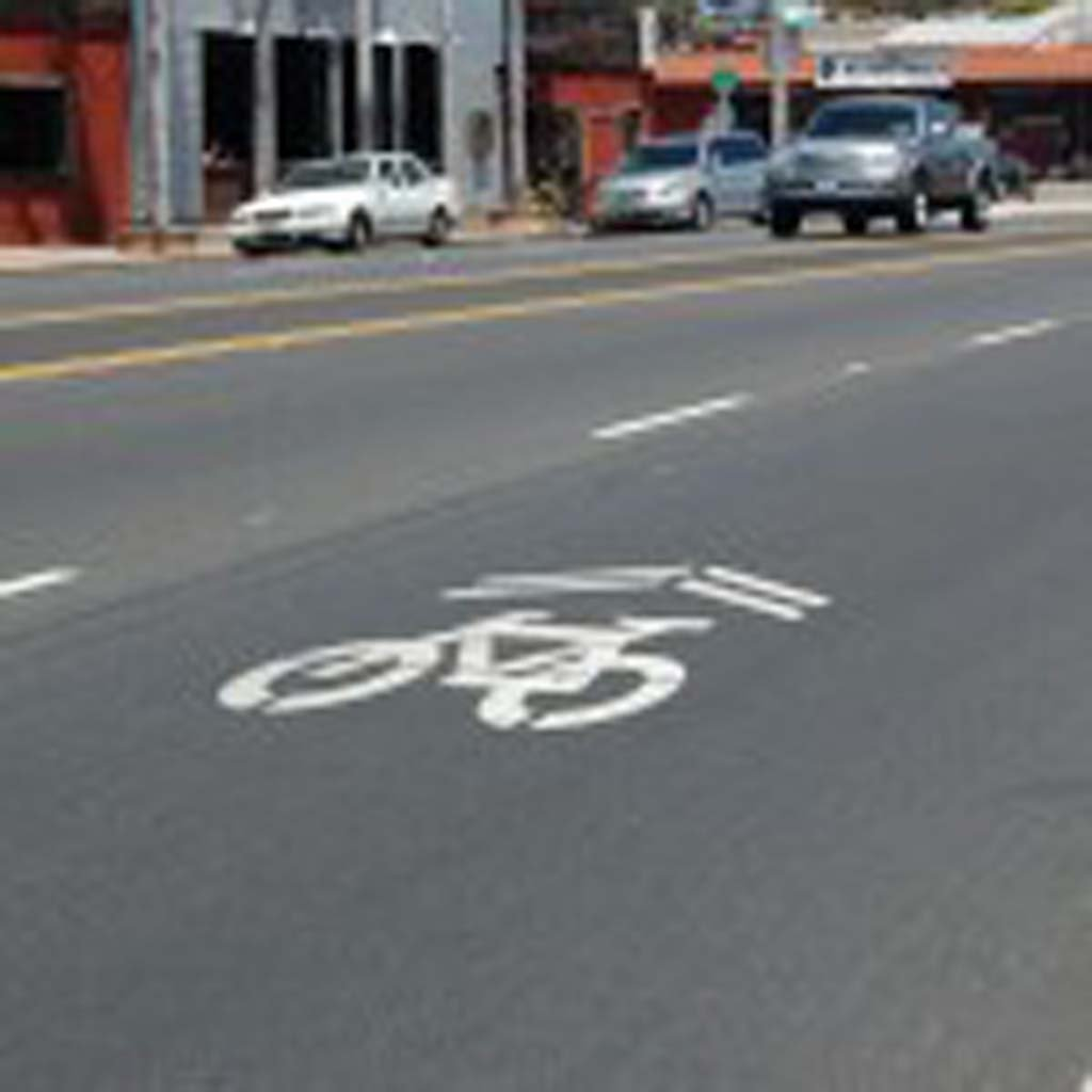 Markings like these currently used in Encinitas will soon be added to Coast Highway 101 in Solana Beach to alert motorists that bicyclists may also use the travel lane. The 4-foot painted icons are called sharrows. Photo by Bianca Kaplanek