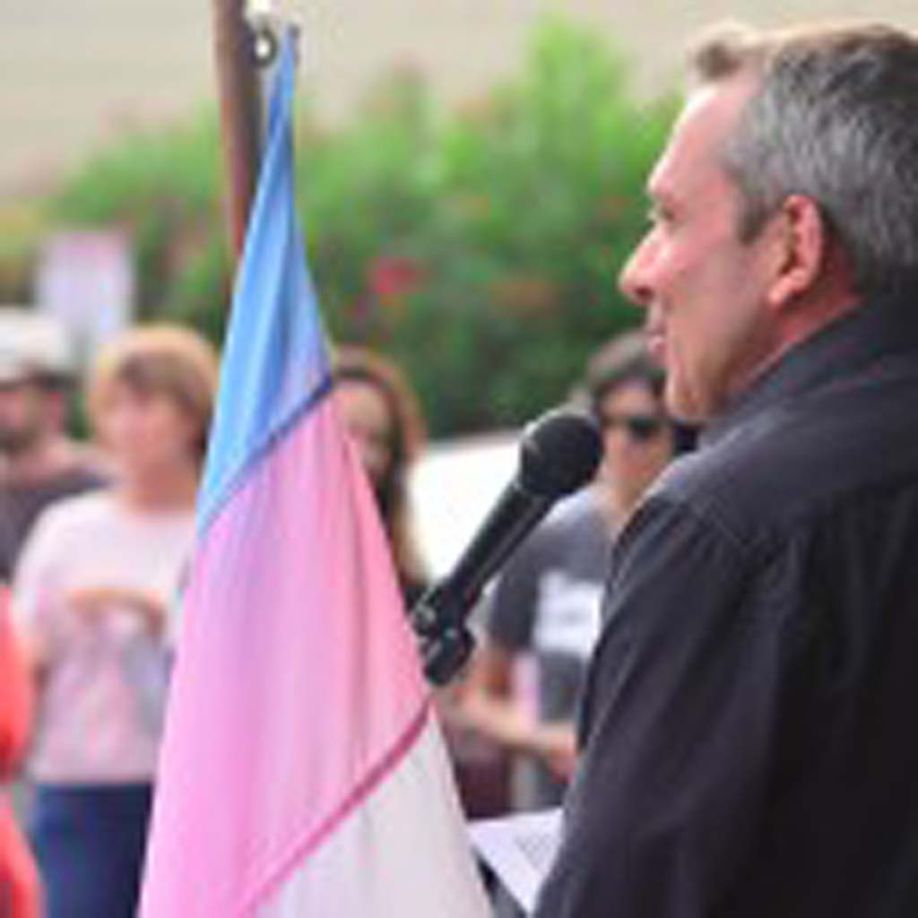 """Executive Director of the North County LGBTQ Resource Center Max Disposti rallies the crowd Wednesday following the rulings issued by the U.S. Supreme Court on same-sex marriage. He says they still have """"a lot of work to do."""" Photo by Tony Cagala"""