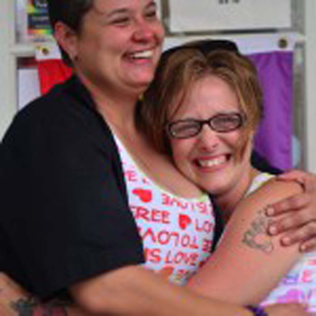 Kindra Fesmire, right, receives a hug from her longtime girlfriend Michelle Coccari, following a successful proposal of marriage at Wednesday's celebration. Photo by Tony Cagala