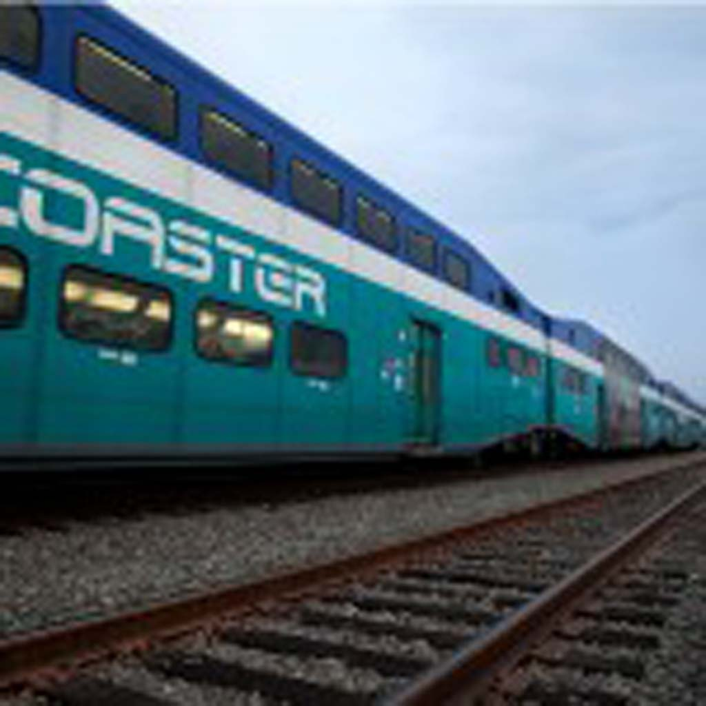 A northbound Coaster train departs from the Carlsbad Poinsettia Station. NCTD passengers can now purchase paperless train tickets on their smartphones. Photo by Paige Nelson