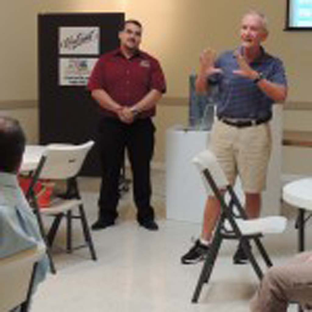 MainStreet Oceanside member Dick Bartlett talks about safety issues in the downtown area including thieves and vagrants at the July 30 stakeholder meeting. Photo by Rachel Stine
