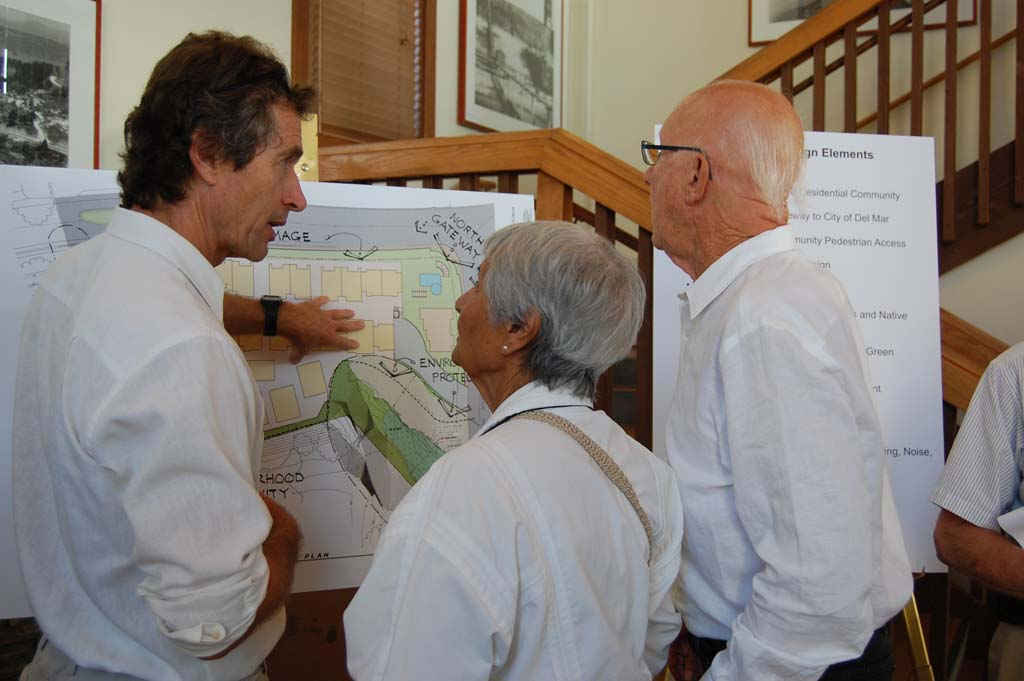 Don Countryman, left, provides details to residents Tensia Trejo and Hershell Price about a proposed housing development on the southwest corner of Jimmy Durante Boulevard and San Dieguito during a July 29 community open house. Photo by Bianca Kaplanek