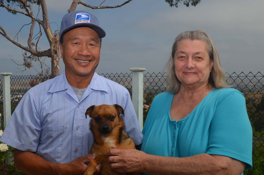 "From left, Mike Tom, Lucky and Helena Cwiek stand together at Cwiek's home in Oceanside. Cwiek calls Tom her ""Guardian Angel,"" for saving her life. After threatening suicide, Tom made her promise every day for two weeks straight that she wouldn't do anything foolish. Photo by Tony Cagala"