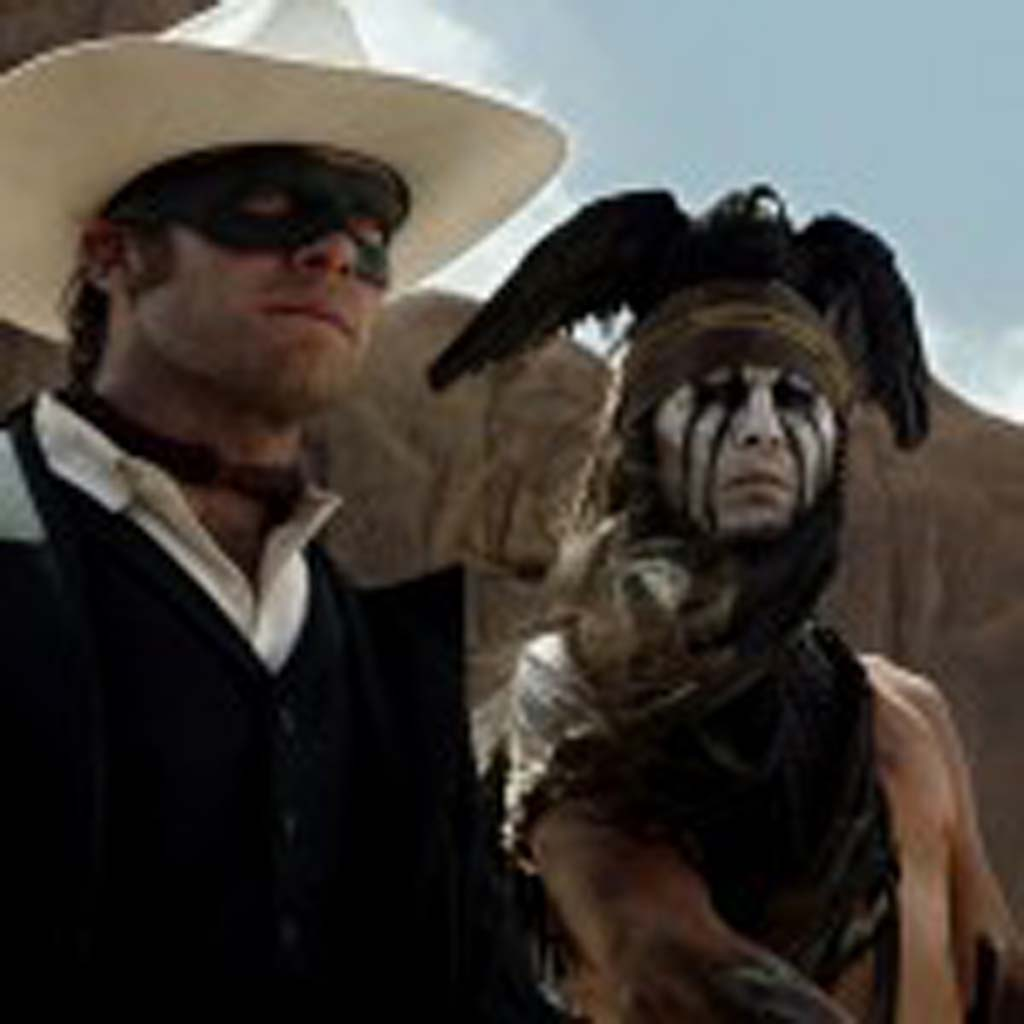 """Armie Hammer, left, as The Lone Ranger and Johnny Depp as Tonto in """"The Lone Ranger,"""" now in theaters. Photo by Peter Mountain"""
