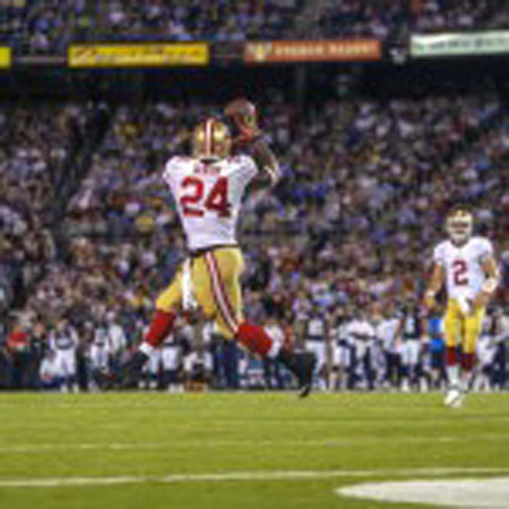 San Francisco 49ers running back Anthony Dixon catches a pass on the run from quarterback Colt McCoy in the 49ers 41-6 win over the Chargers at Qualcomm. Photo by Bill Reilly