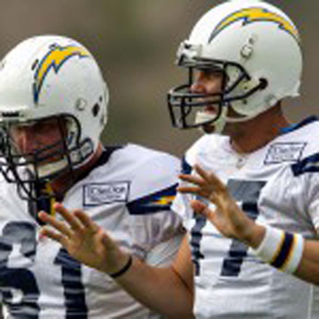 Chargers quarterback Philip Rivers, right, at training camp this season with center Nick Hardwick. During the offseason, Rivers and his family experienced a special moment while visiting the Vatican. File photo by Bill Reilly