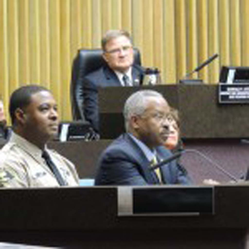 Cmdr. Will Brown, left, and Chief Probation Officer Mack Jenkins, right, presents an update about the county's implementation of the state's prison realignment before the County Board of Supervisors at their Sept. 24 meeting. Photo by Rachel Stine