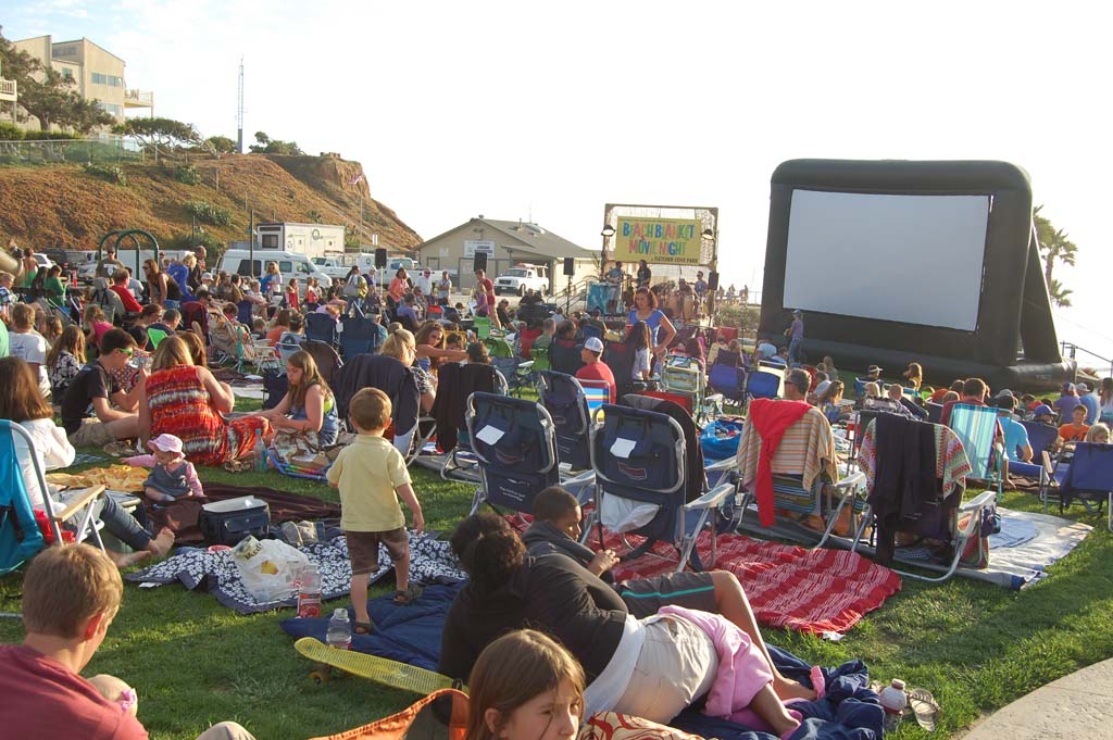 """Hundreds of people gathered at Fletcher Cove Park on Aug. 24 for the ninth annual Beach Blanket Movie Night, which included music by Aloha Radio, snacks, a raffle and this year's feature film, """"Chasing Mavericks."""" Photo by Bianca Kaplanek"""