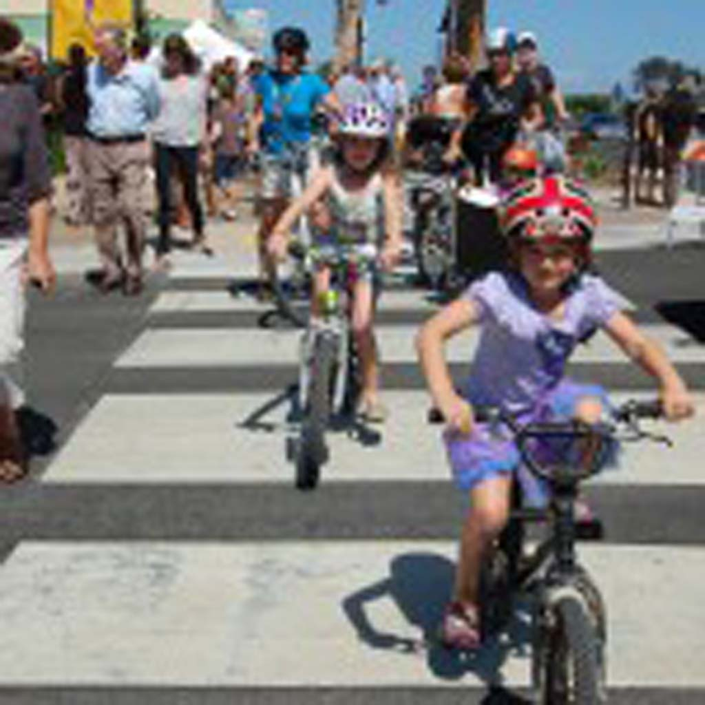 Caroline Wagner, 8, and Daisy Graziano, 6, get ready for a ceremonial bike ride along the newly renovated Coast Highway 101. Photo by Bianca Kaplanek