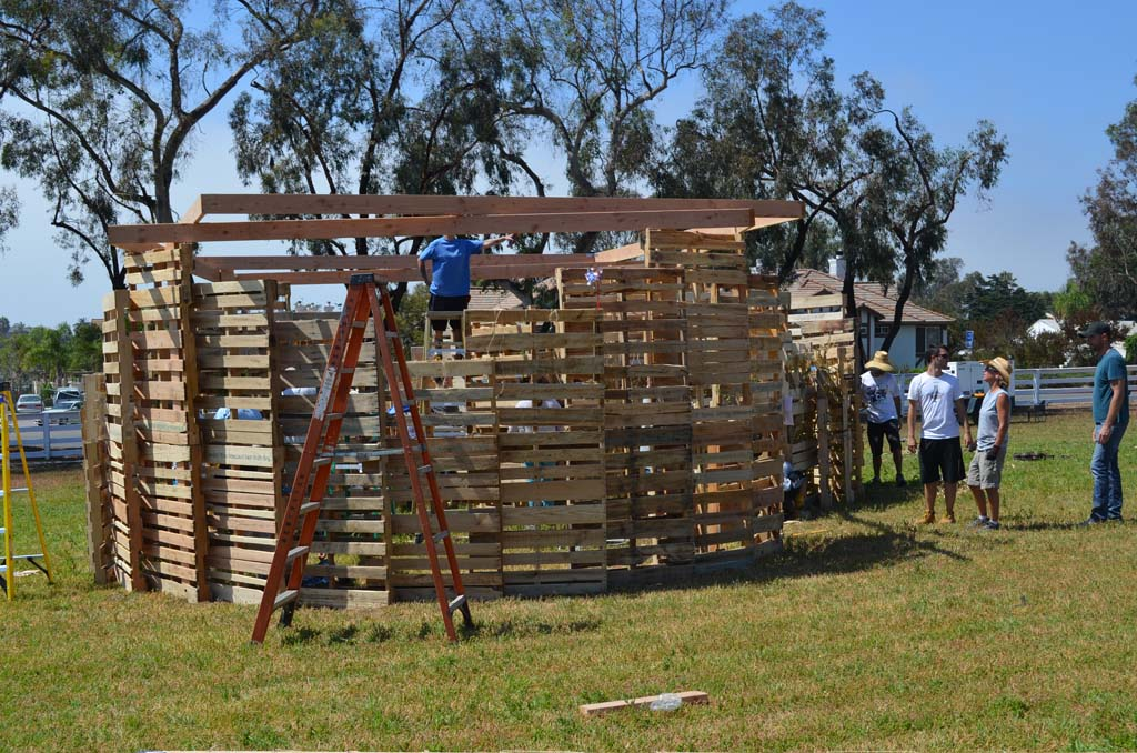 Volunteers work on a Sukkah — a temporary structure that represents harvests among the Jewish community — on Sept. 15. The Leichtag Foundation wants to promote agricultural heritage with more events like the Sukkah Design Festival. Photo by Jared Whitlock