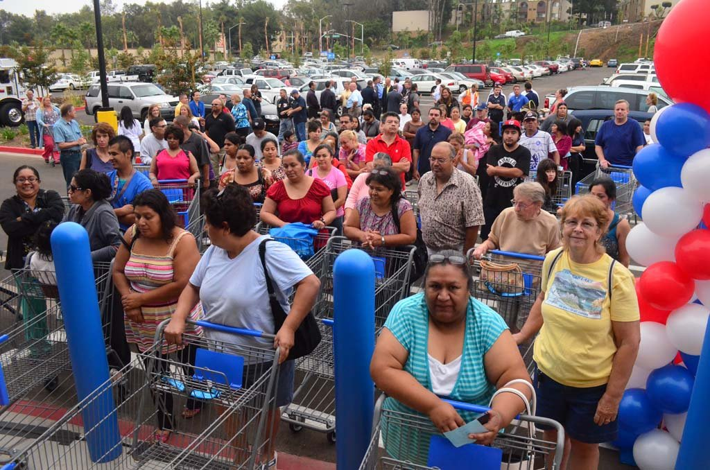 Shoppers line up before entering the new Walmart in Escondido during the grand opening on Wednesday. The store is the first in the city with a second Walmart grocery store to open nearby sometime early next year. Photo by Tony Cagala