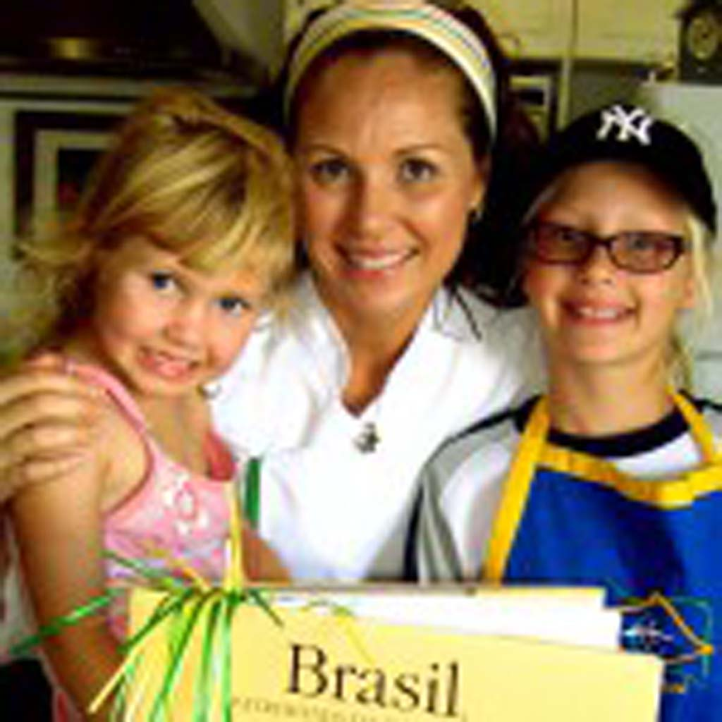 Cook for Thought founder Fernanda Larson, center, with daughters Giulia, left, and Sophia. Larson uses cooking to teach reading, writing and arithmetic as well as science, social studies and other subjects through the Del Mar Union School District. Photo by Lillian Cox