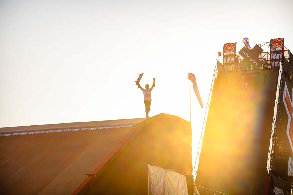 Vista resident Elliot Sloan raises his arms in celebration after a run on the mega ramp. The run would earn Sloan an X-Games gold medal in the big air competition earlier this year in Los Angeles. Photo by Michael Barbuti