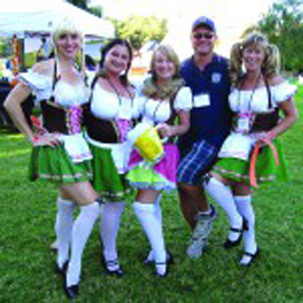 Rotary frauleins, from left, Dawn Van Siclen, Kori Dolkas, Wendy Wiegand and Lisa Rodman serve up this year's Oktoberfest with Rotarian Mark Ealy. Courtesy photo