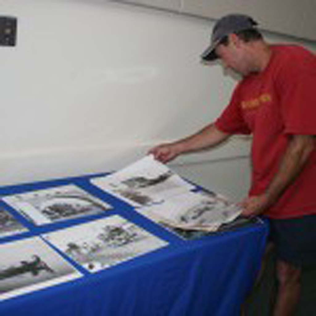 Dennis Jardin, of Oceanside, looks through historic city photos. Oceanside is celebrating its 125th anniversary. Photo by Promise Yee