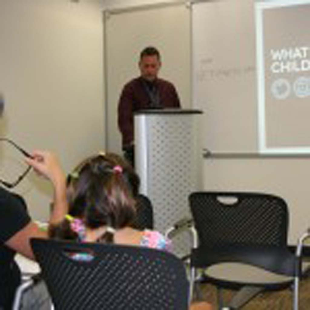 Detective Joshua Morris shares tips on how to keep kids safe online. The presentation was given at Civic Center Library in response to parents' requests. Photo by Promise Yee