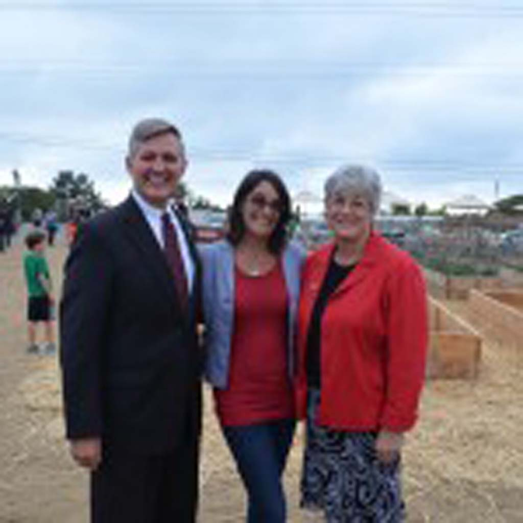 From left: San Diego Supervisor Dave Roberts, Mim Michelove and Deputy Mayor Lisa Shaffer pose in front of planters at the Ocean Knoll farm. Photo by Jared Whitlock