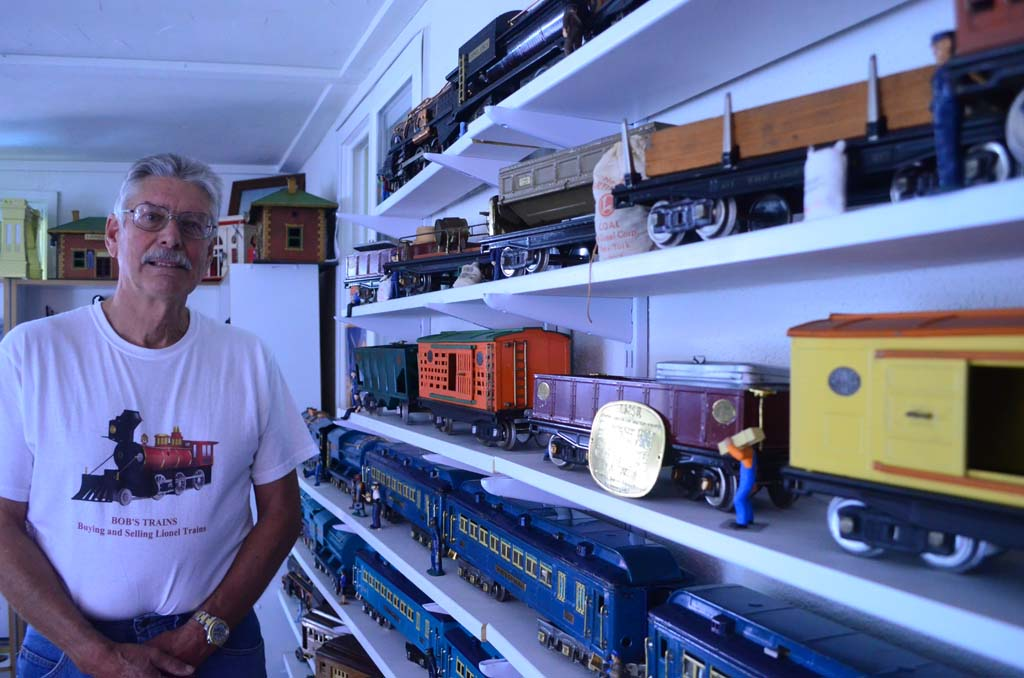 Cardiff resident Bob Schutlz has amassed about 1,000 model trains since he began collecting them three years ago. The retired real estate broker buys, sells, repairs and gives away train sets. Photo by Tony Cagala