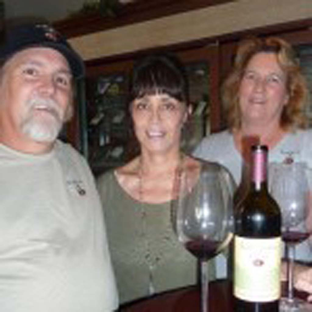 Powell Mt. Vineyards owners Bill and Kim Powell visit with Ellena Cassidy, middle, of Encinitas Wine Merchants. Photo by Frank Mangio