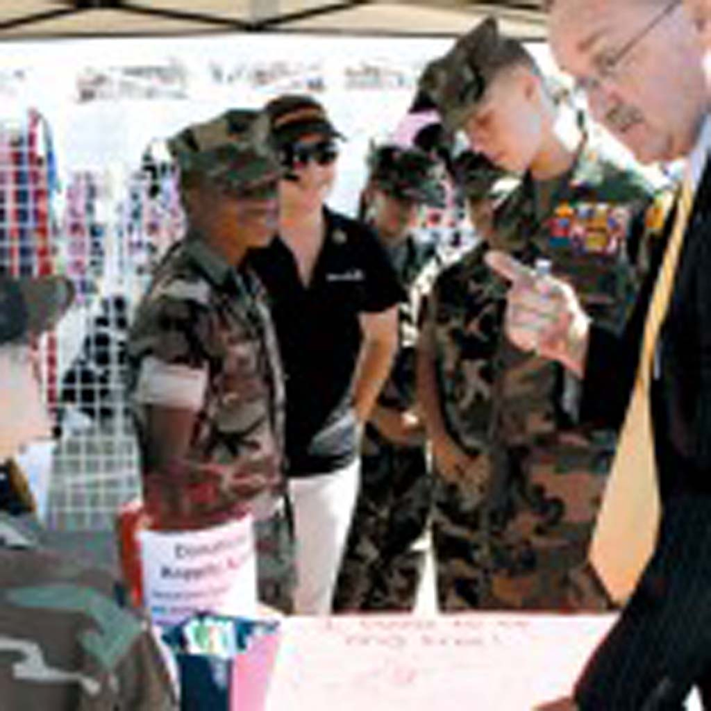 Mayor Jim Wood, right, signs the Camp Pendleton Young Marines' pledge to be drug free at the recent Harbor Days event. Young Marines campaign for drug use prevention throughout the year. Photo by Promise Yee