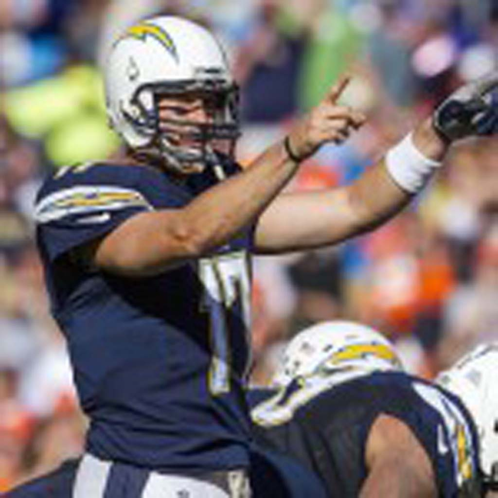 Quarterback Philip Rivers points out defenders to block. Photo by Bill Reilly