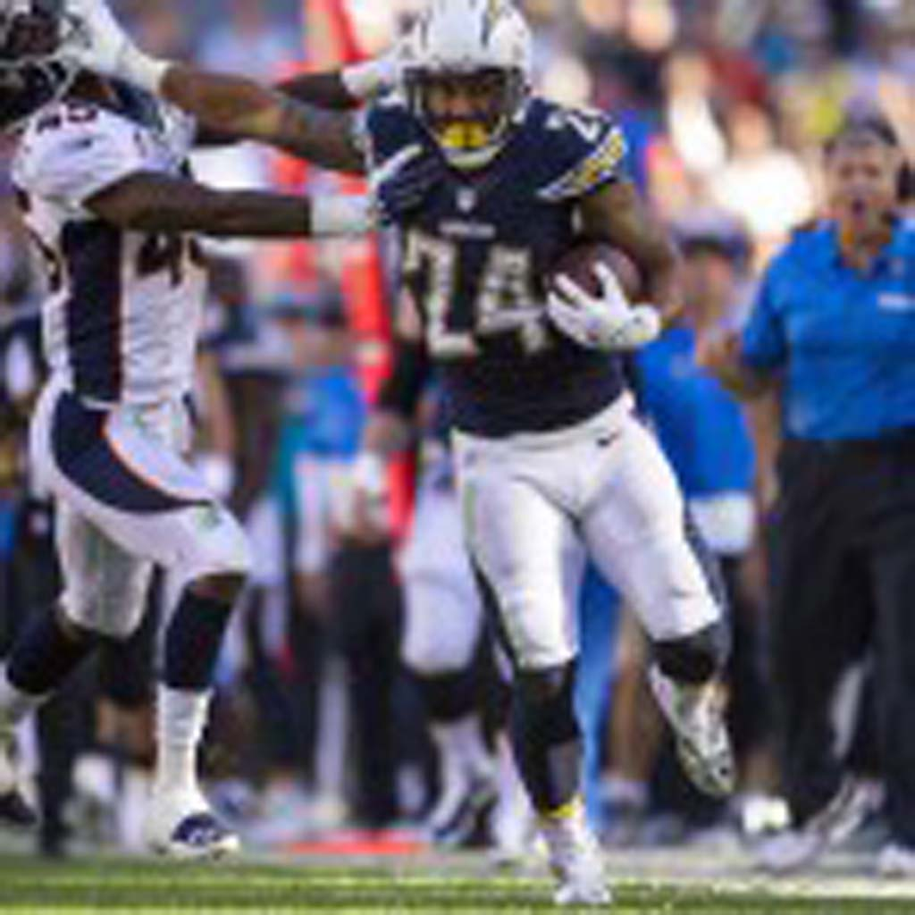 Running back Ryan Mathews uses a stiff arm to gain extra yards during a run. Photo by Bill Reilly