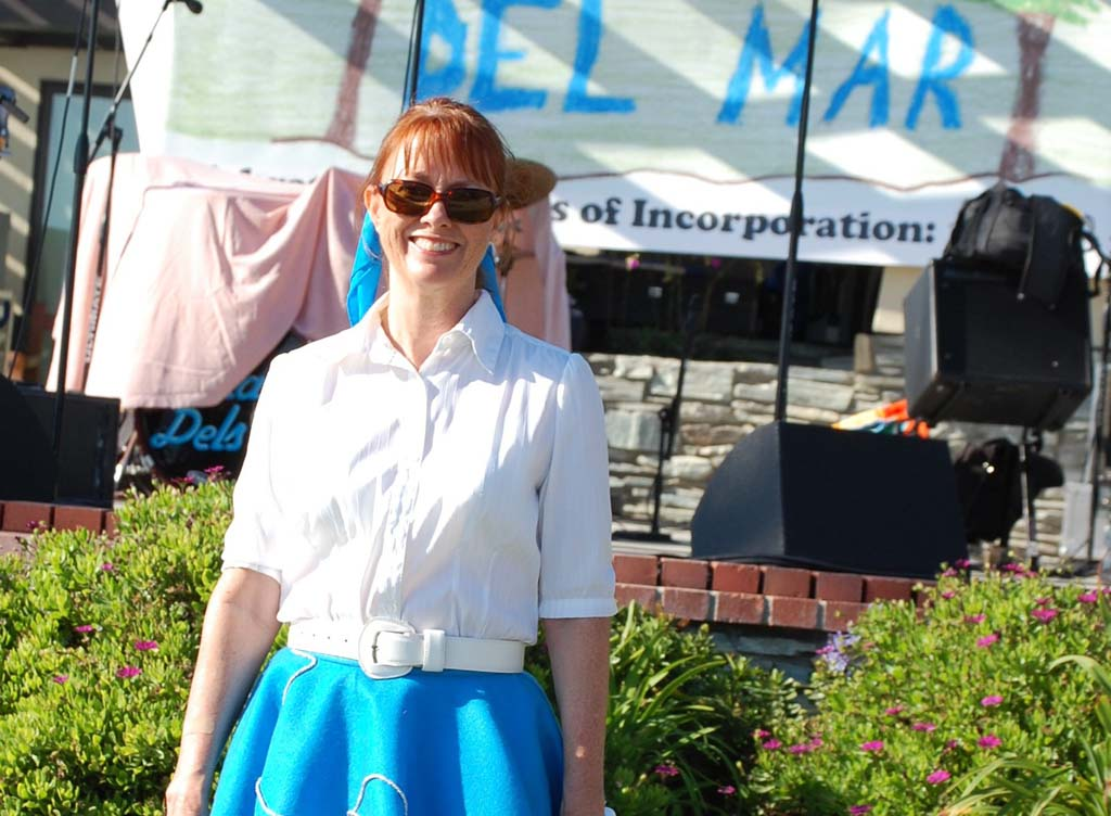 When it comes to Del Mar, City Clerk Mercedes Martin has always given it her all, including donning a saddle shoes and a poodle skirt for the city's 50th anniversary celebration in 2008. Martin is retiring Dec. 2 after more than 25 years of service to the city. Photo by Bianca Kaplanek