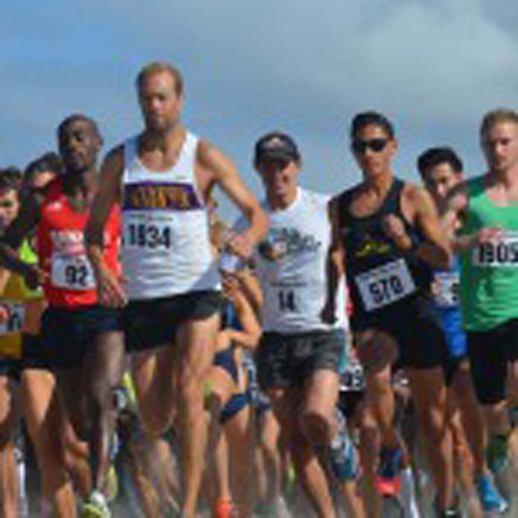 Racers break from the starting line.