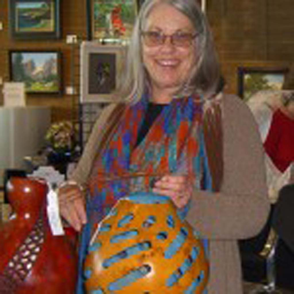 Grace Swanson displaying her artistic gourds at the 2012 holiday art fair. Image courtesy of Gaga Barnes