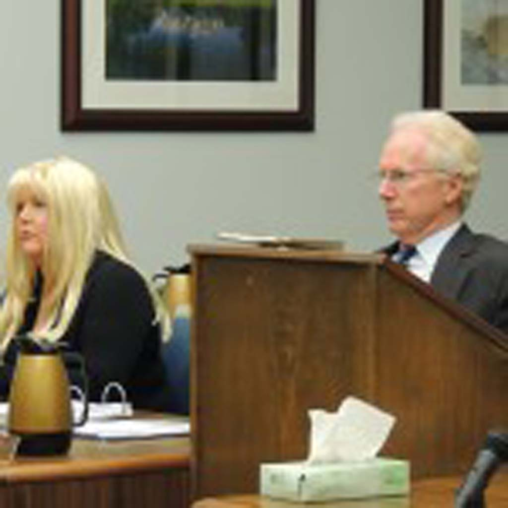 """Former San Diego County District Attorney Paul Pfingst, right, repeatedly called accusations that he improperly altered evidence during the investigation of Jason Harper's murder """"phony"""" during a Nov. 22 court hearing. He is representing Julie Harper, left, who is charged with fatally shooting her husband Jason Harper last year. Photo by Rachel Stine"""