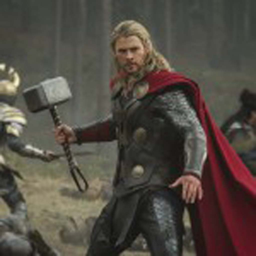 """Thor (Chris Hemsworth) returns to fight to save the universe from darkness in """"Thor: The Dark World."""" Photo by Jay Maidment"""
