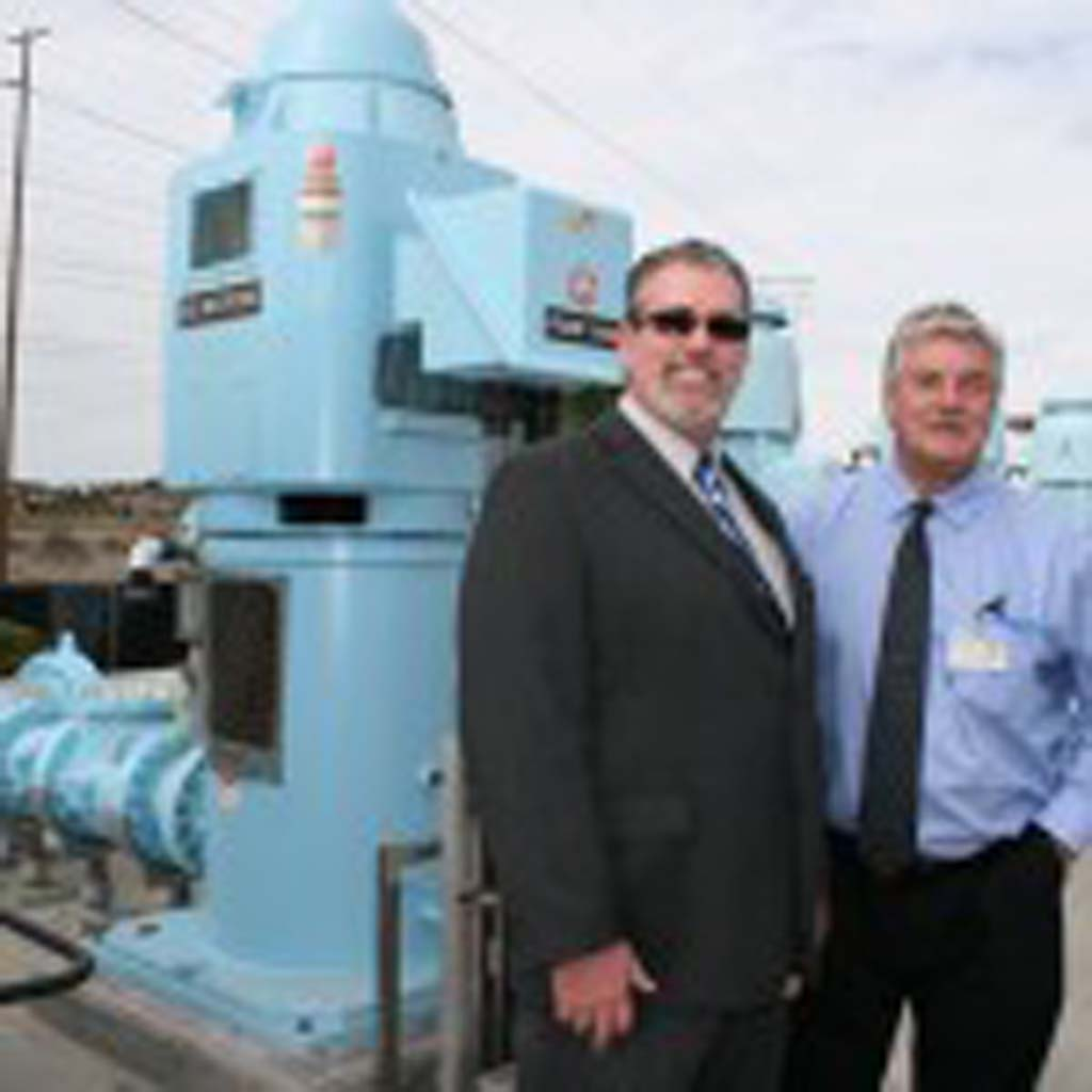 Jason Dafforn, water utilities division manager, and Gary Bodman, wastewater project manager, show off new 350 horsepower pumps. The set of 150 horsepower pumps used at the facility are on the right. Photo by Promise Yee