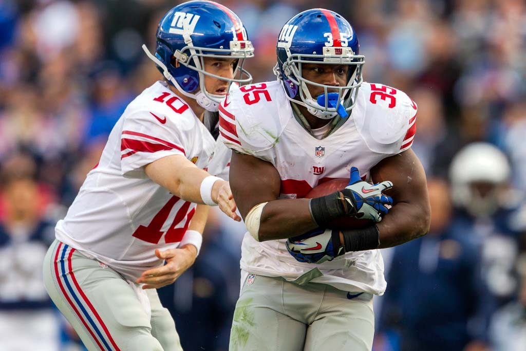 Giants quarterback Eli Manning (10) hands the ball off to running back Andre Brown (35) during the second quarter of the game at Qualcomm Stadium.