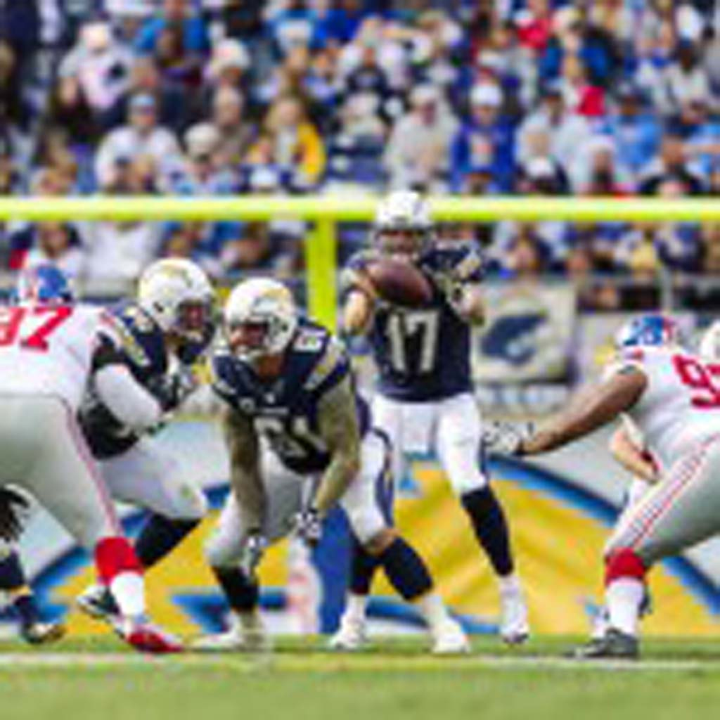 Chargers quarterback Philip Rivers (17) handles the snap during the first quarter as the Chargers took on the New York Giants Sunday at Qualcomm Stadium.