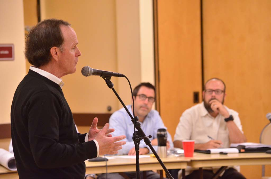 A San Marcos resident voices concerns to the consulting firm Consultants Collaborative and to the city's planning commission, over the proposed San Marcos Highlands housing development on 293-acres just north of Santa Fe Hills. Photo by Tony Cagala