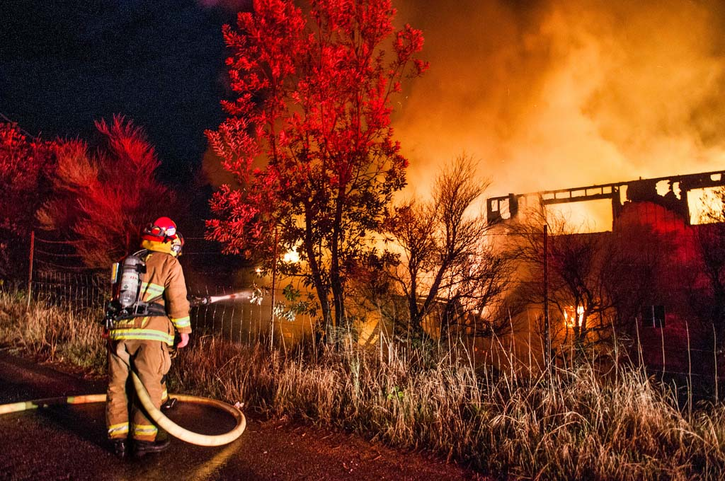 Cal Fire firefighters battle a fire in Valley Center in November 2013. Photo by Anthony Carrasco, courtesy of Cal Fire