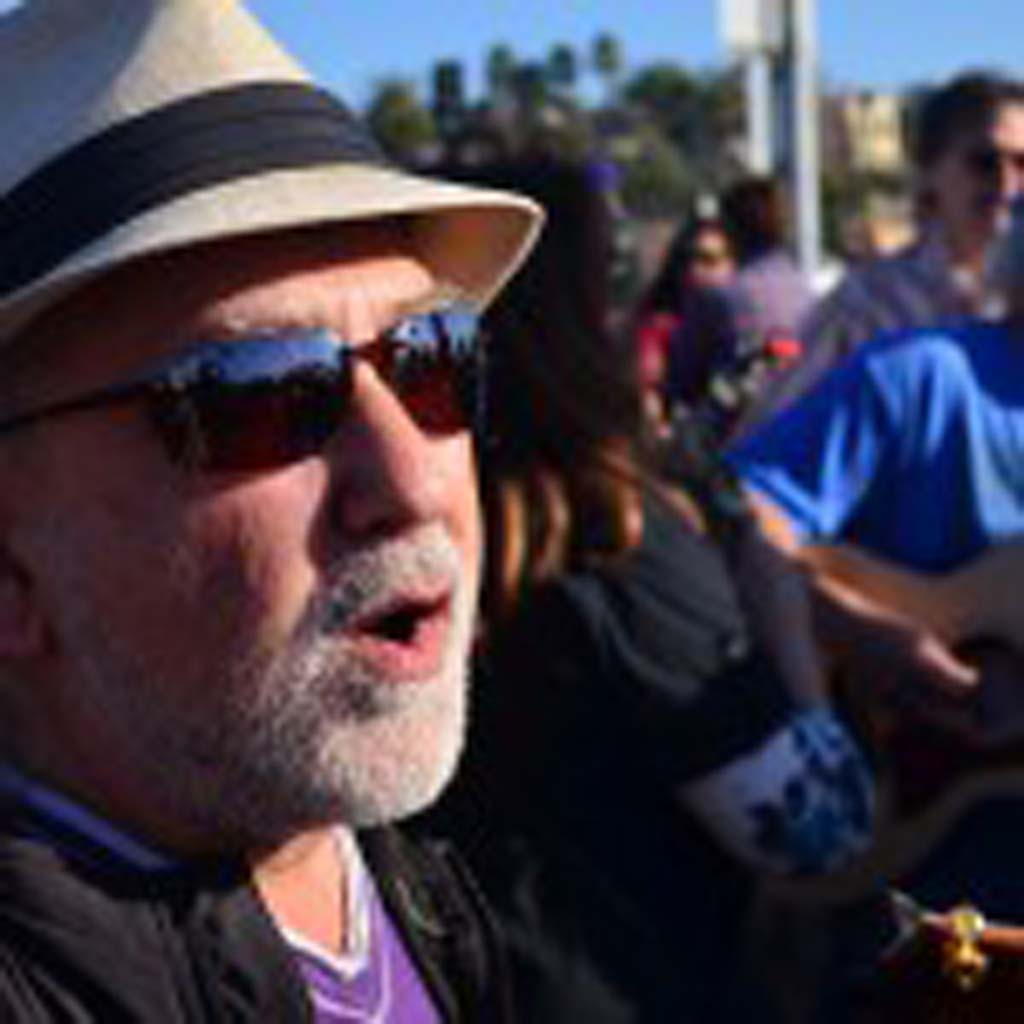 """Jacques Cohen, left, belts out a verse of """"Midnight Special,"""" at the second annual Splash Jam. Photo by Tony Cagala"""