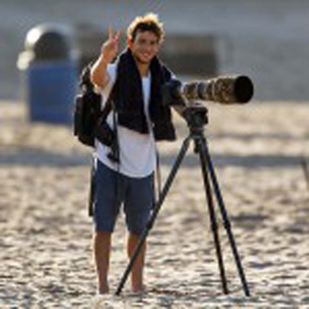 Surf photographer and Solana Beach resident Todd Glaser at an Oceanside beach in 2012 during a photo shoot. Photo by Bill Reilly