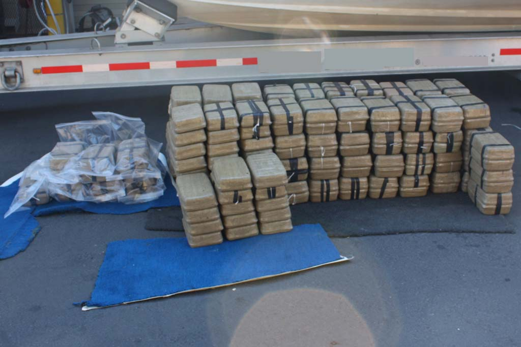 Agents find 200 packages of methamphetamine tightly wrapped with plastic inside the compartment of U.S. citizen's boat during a search in Oceanside Harbor. Photo courtesy of U.S. Border Patrol