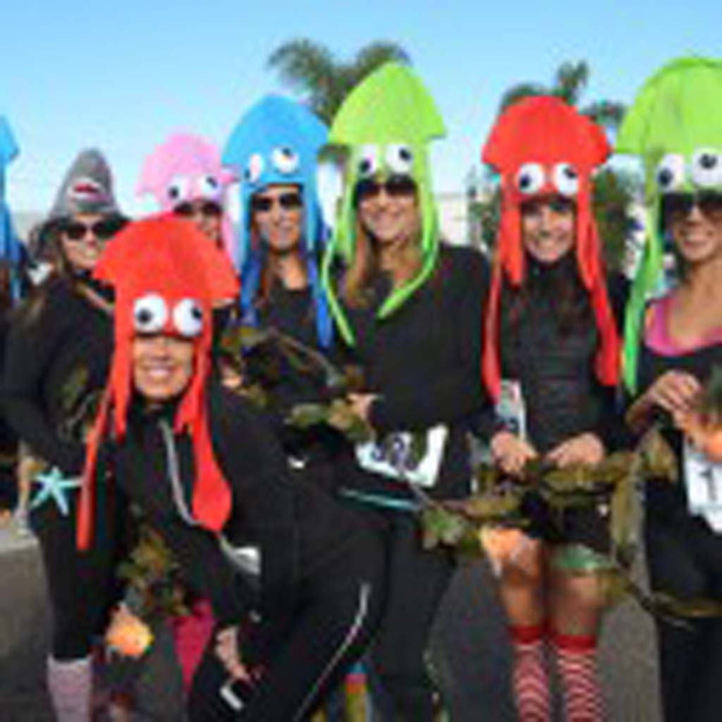 Another of the group costume contest winners came dressed as squids and a shark. They were tethered together by seaweed throughout the race. Photo by Tony Cagala