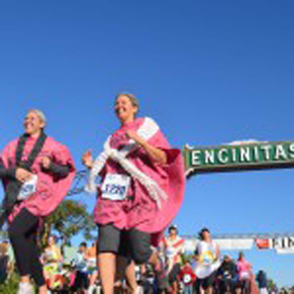 """Calling themselves the """"old farts,"""" a group of runners dress up wearing whoopee cushions, take part in the 5k portion of the race. Photo by Tony Cagala"""